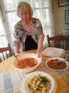 Lois Rogers readies a variety of foods for Lent and Holy Week, including warm lentil salad for Holy Thursday, pictured at right.